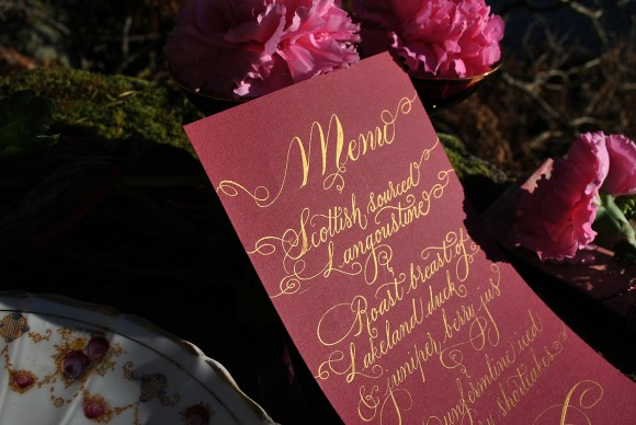 Calligraphy menu close up gold lettering